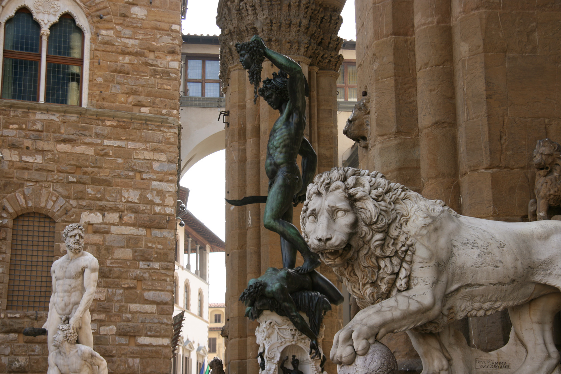 Front: lion and Perseus at Loggia dei Lanzi. Back: Hercules and Cacus in front of the Palazzo Vecchio.