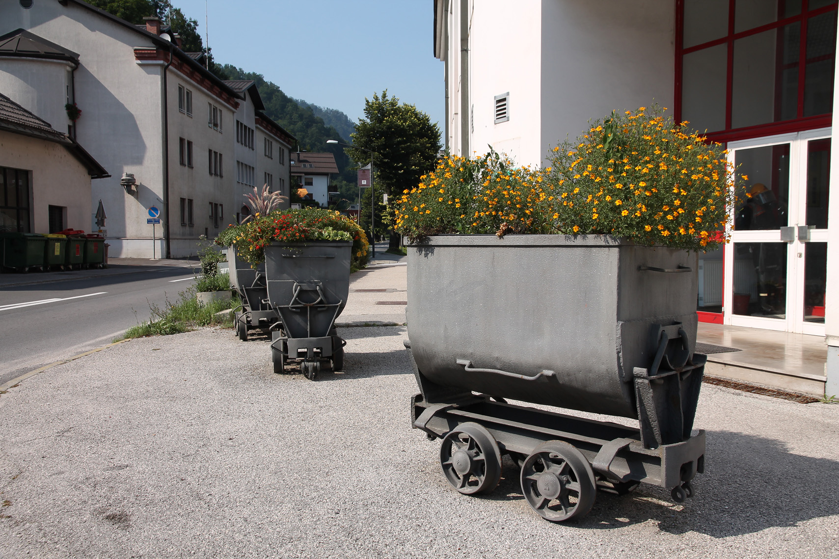 Mine carts, used as flower pots, in front of the fire station.