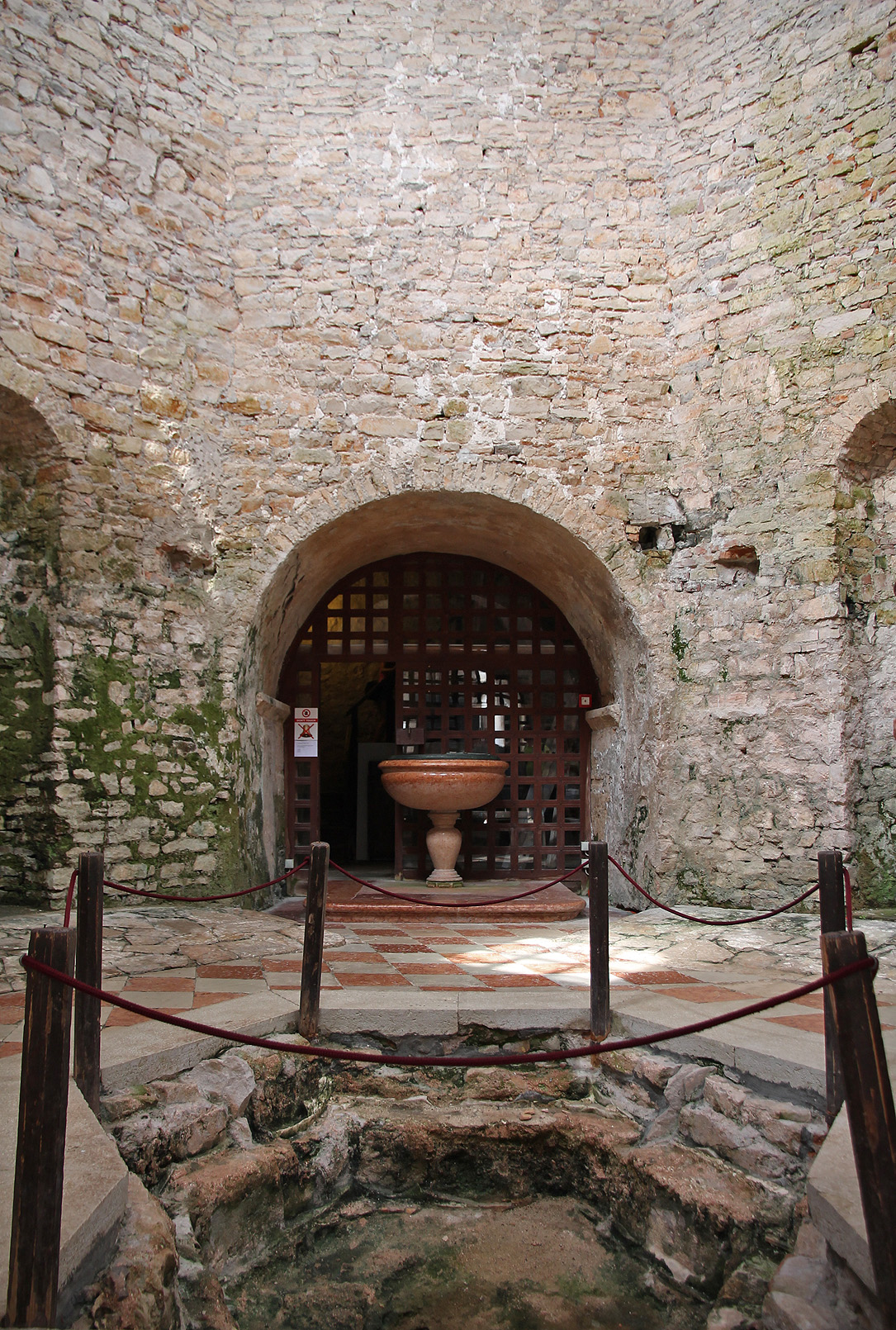 The baptistery. The gate leads to the bell tower.