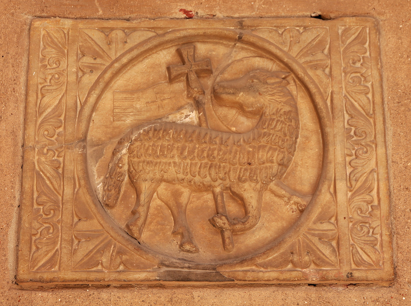 Half-relief of the lamb of God (Agnus Dei) in the atrium wall.