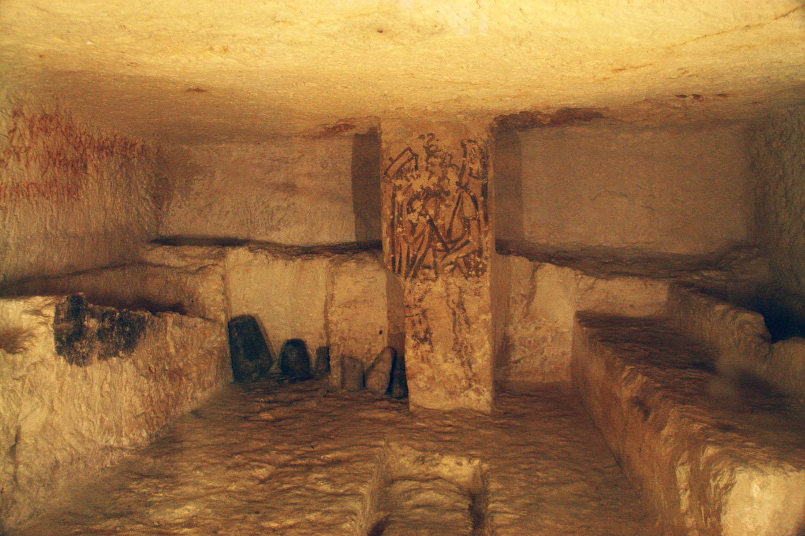"""Tomba 5636"", a different type of tomb. It dates back to the second half of the third century B.C. The graves are carved into stone benches next to the walls."