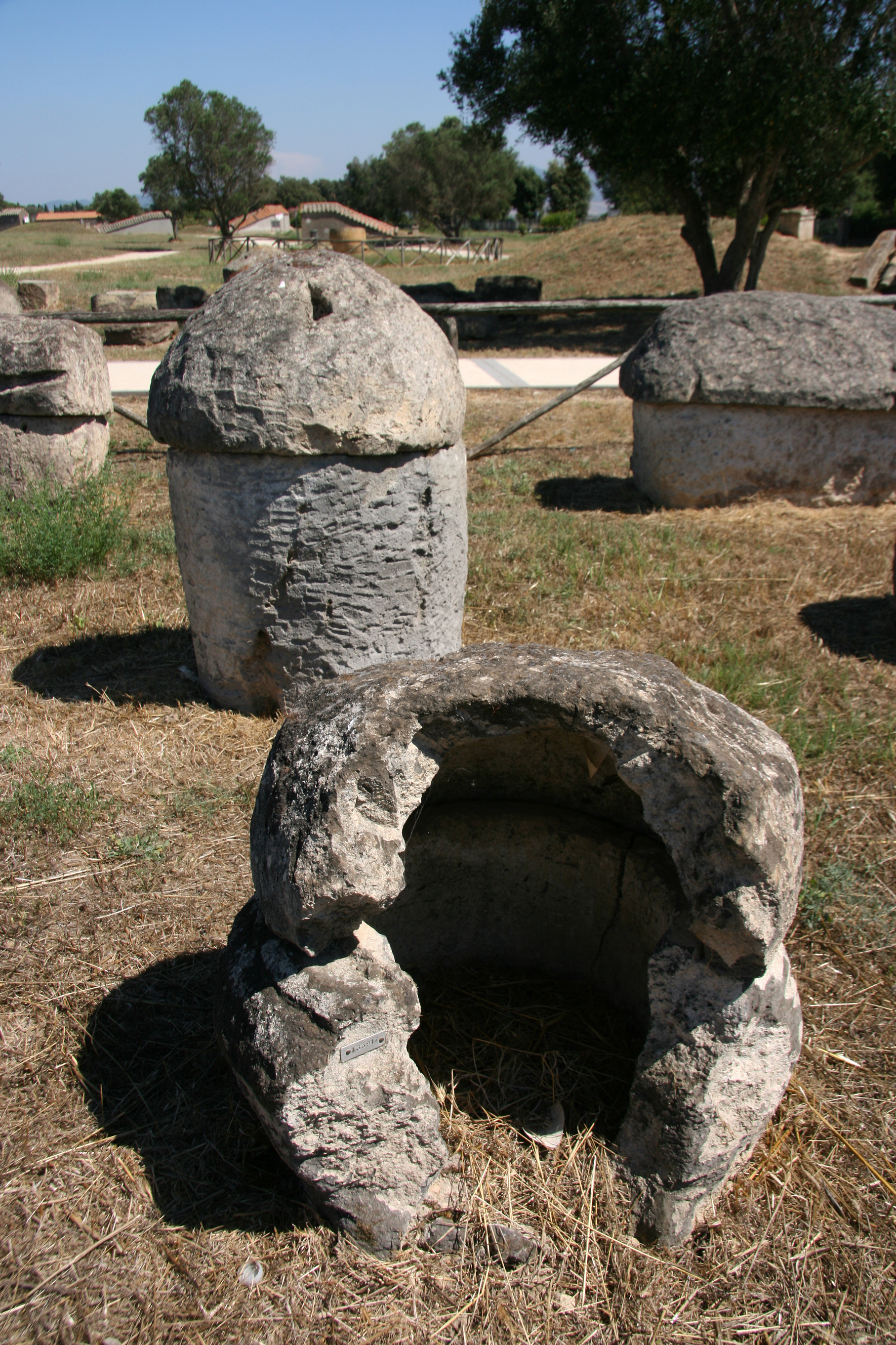 Stone urns are scattered about the place.