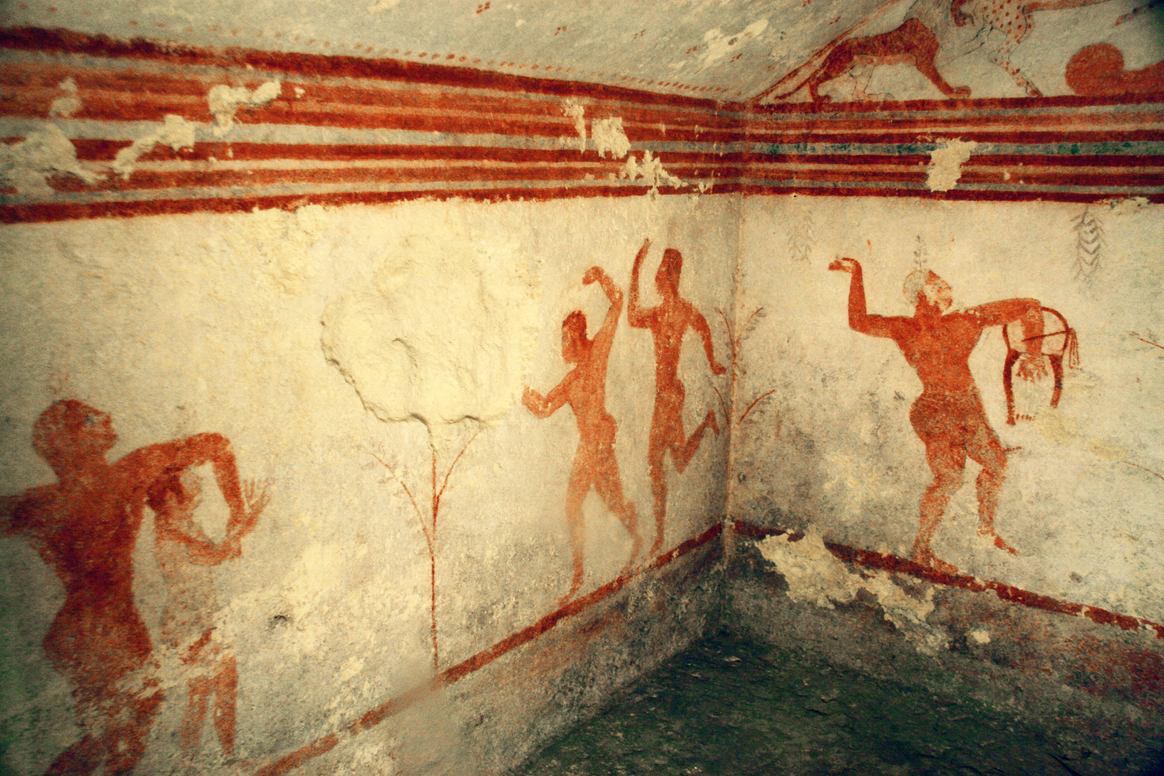 The dance shown here is an orgiastic dance in honour of Dionysus. The dancers are singing, and some are holding wine cups. (Tomba dei Baccanti, 510-500 B.C.)