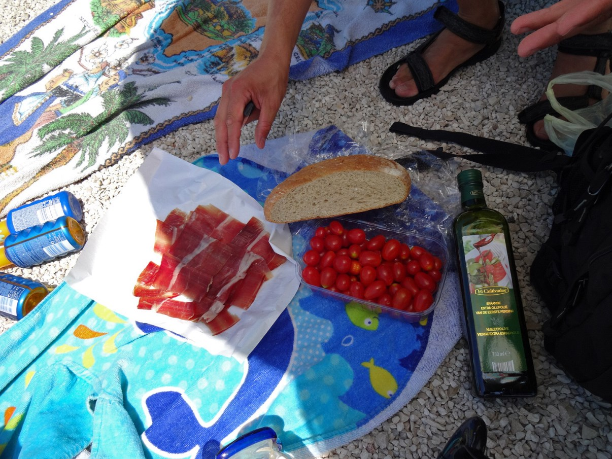 Enjoying the pršut with some cerry tomatoes, a piece of local bread and some olive oil.