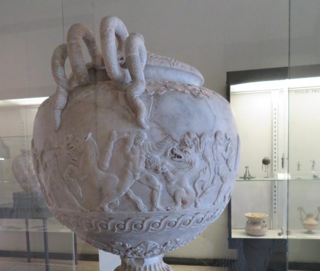 Herakles fighting a dragon on an antique vase.