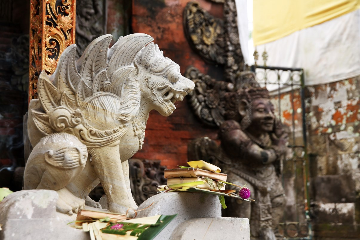 A winged lion at the entrance of the temple.
