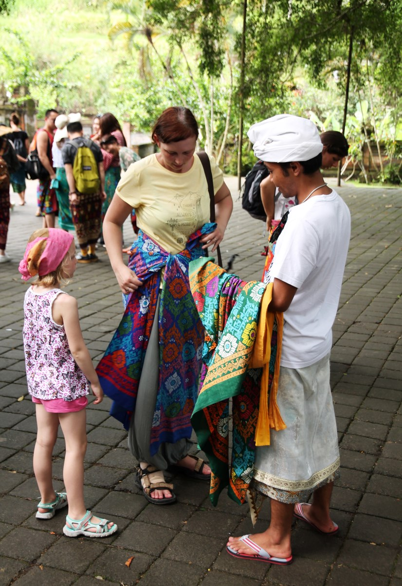 Adults are obliged to wear a sarong (and belt) when entering a temple.