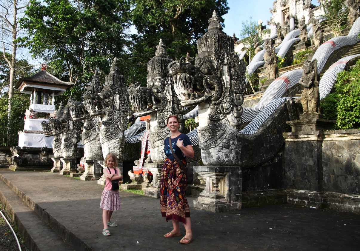 The dragons of Pura Lempuyang Luhur with two travelers...