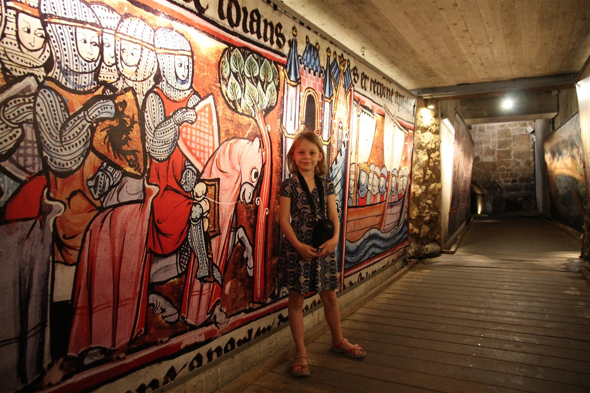 The tunnel is decorated with medieval themes.