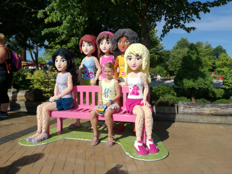 With her friends from Lego Friends.
