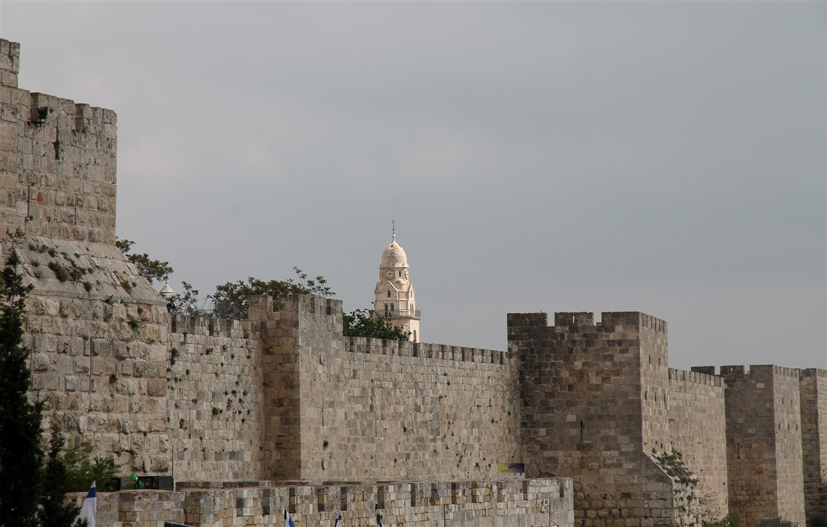 The city wall and the bell tower of the Church of the Dormition.